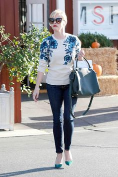 Reese Witherspoon looking chic and feminine in a floral sweater by Tory Burch.
