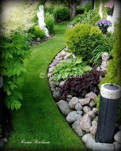 Beautiful curved flower bed with rock garden