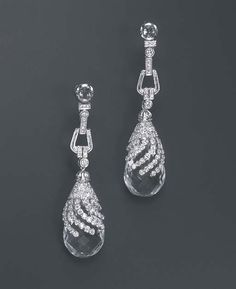 A PAIR OF DIAMOND AND ROCK CRYSTAL EAR PENDANTS. Each briolette-cut rock crystal pendant, with a circular-cut diamond cap, suspended by similarly-set links to the rose-cut diamond surmount, mounted in 18k white gold