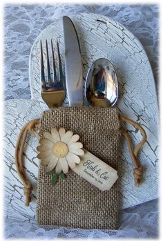 Rustic but elegant BURLAP WEDDING FAVOR bags with vintage looking beige daisy and custom tag - set of 10. $20.00, via Etsy.