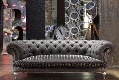 grey velvet tufted couch.