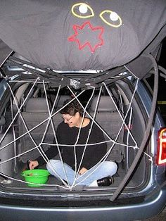 Decorate Your Car For Trunk or Treat make a spider web and hand out candy dressed like a spider