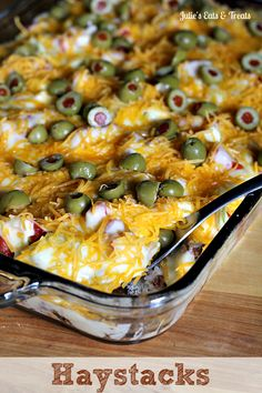Haystacks Casserole (rice, taco meat, cheese sauce, tomatoes, olives, tortilla chips)