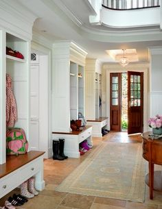 Traditional entryway (well that is the most formal mudroom I've ever seen!)