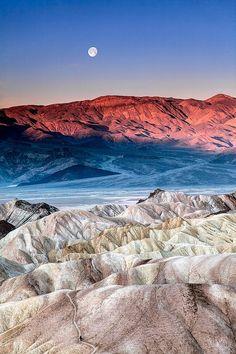 Moonset at sunrise. Death Valley National Park, California, USA