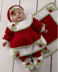 PB036 Christmas Baby Doll Set Crochet Pattern.  Little girls love to wear pretty dresses, but some love to dress their baby dolls even more than themselves. Make your little one's doll more festive with the Christmas Baby Doll Set. This colorful outfit features an afghan, dress, pants, hat, and booties with a pretty holiday flare that you won't find in store bought doll clothing.