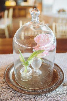 bud vase under a bell jar, photo by Paper Antler http://ruffledblog.com/romantic-atlanta-wedding #weddingideas #centerpieces