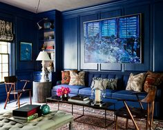 .dark blue walls and sofa