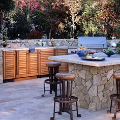 We love the look of this outdoor kitchen! More pictures here: http://www.bhg.com/home-improvement/patio/designs/patio-furniture-ideas/?socsrc=bhgpin081914outdoorkitchen&page=10