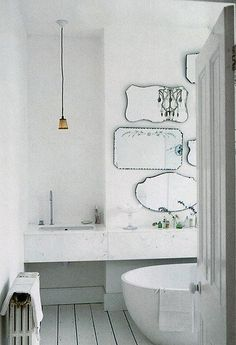 Mirror collage above vanity; smaller scale but love the style of these select mirrors.
