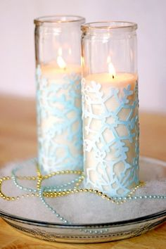 Snowflake die cut sheet Mod Podged onto tall glass votives! Love it!