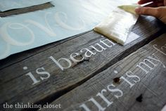 DIY vinyl lettering on wood ( paint words on pieces of wood pallet for my powder bath wall )
