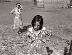 "August 1939. ""Washington, Yakima Valley, near Wapato. One of Chris Adolph's younger children. FSA rehab clients"" Photo by Dorothea Lange   Ruthie resource. Ma's apron resource"