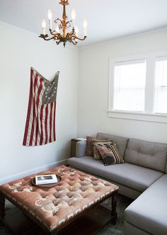backpacks, interior, coffee tables, apartment style, flag, wool rug, white walls, stool, small spaces