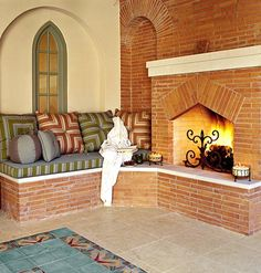 fireplace and comfy bench