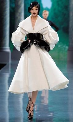 White Dior Coat with BIG Black Belt FROM: Catwalk trend: wasp waists at the haute couture autumn Winter 2008-2009 shows - Haute couture highlights: all the trends from the catwalks i...