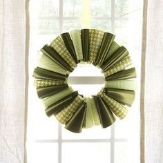 Beyond Greenery | Don't throw away those small scraps of paper left over after you've wrapped all the gifts. Turn them into a wreath. Loosely roll up each piece and use a dot of hot glue to secure it. | SouthernLiving.com