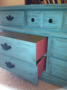 DIY. Surfer Teal Behr paint. Let Dry. [Lightly] brush on Valspar Antiquing Glaze & wipe with a cloth until you get the look you want! Paint inside drawers [Pink] or any color you want! :)