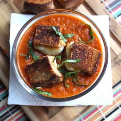 Roasted tomato-basil soup with grilled cheese croutons.