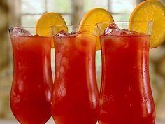 The Hurricane: 2 oz light rum, 2 oz dark rum, 2 oz passion fruit juice, 1 oz orange juice,  1 oz fresh lime juice, 1 Tbs simple syrup, 1 Tbs grenadine, orange slice and cherry for garnish