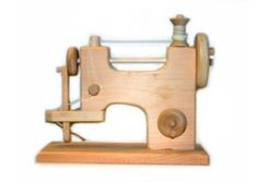 Wooden Toy Sewing Machine...because she always wants to help me work :)