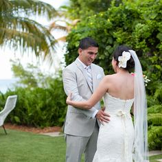 """Brides.com: Romantic First-Look Photos from Real Weddings. Though Vanessa and Ariel shared a special pre-ceremony moment at their destination wedding in Vieques Island, Puerto Rico, """"The most special part of the ceremony was listening to the vows we had written for each other,"""" Vanessa says of the couple's service, which was held on a grassy knoll steps from the water.  See more photos from Vanessa and Ariel's wedding."""