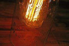 This vintage open-bottom Mason jar pendant light will bring a rustic touch to your home decor. Love the antique Edison bulb! #vintagelight #masonjar #pendantlight