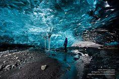 Hiker in a Icecave in Vatnajokull glacier