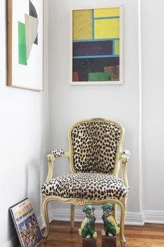 Lonny September 2013: Modern art hangs above a cheetah print French style chair in Max Humphrey's West Hollywood apartment.