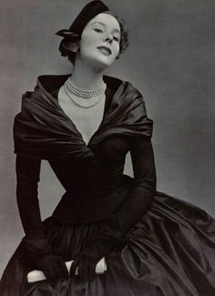 I adore the way Dior balanced the fuller than full skirt with the elegant drapery at the neckline.  Dior Haute Couture, Fall 1951.