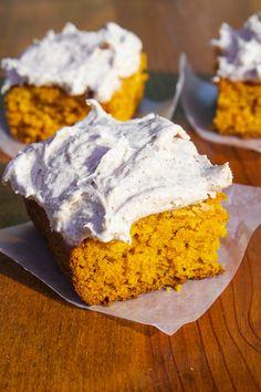 Moist Pumpkin Bars with Fluffy Cinnamon Cream Cheese Frosting.