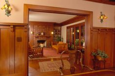 We completely restored the  (1909) Ashbourne House by architect Frederick Noonan. Entry and principal rooms on first floor were restored to their original appearance, while upstairs bedrooms and baths were reworked.  Night view of restored living room taken from dining room shows restored woodwork and tile fireplace.
