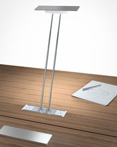 Levity from Byrne - a table-top lamp that telescopes outward when you need it, and also provides electrical access.