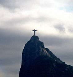Christ the Redeemer Statue - also known as Christ of the Andes - towers over Rio de Janeiro , Brazil