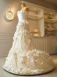 Look it's a dress... No wait it's a cake!!! Way cool! Cake Boss    TLC Cake Smash A life-size, wedding-dress cake is requested by a bridal shop, and the owners will give a free dress to the bride who can find a golden coin hidden inside. Meanwhile, Buddy bakes cakes for a cake-smash photo shoot.