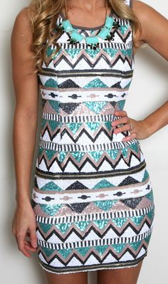 turquoise and white tribal print dress. short, slim fitting, sleeveless summer dress.