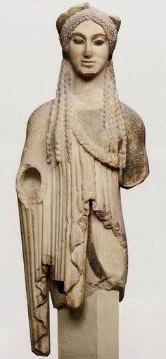 "THE ""KORE WITH THE EYES OF A SPHINX""_ Votive offering to Athena. Attic work in Parian marble. From the Acropolis of Athens, ca 500 BC. Athens, Acropolis Museum (by Metropolitan Museum Athens)"