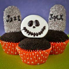 Graveyard Cupcakes for Halloween.  Love the easy Jack Skellington marshmallow topper!