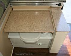 Pop Up Camper Makeover:  Use Rustoleum Countertop Transformations to redo the countertops in your pop up trailer.