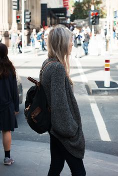Oversized sweater + backpack.