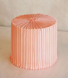 Cake iced and stripe-piped in same colour.