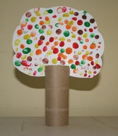 cute craft to hang? kids fingerprints in fun colors using toilet paper rolls as the tree trunk