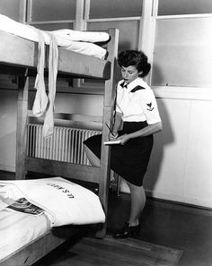 Specialist (S) 3rd class Aspasia Phoutrides inspecting WAVES barracks at the Advanced Naval Training Station, Lake Union, Seattle, Washington, United States, 18 Sep 1943.