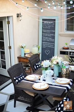 An oversized frame chalkboard makes a perfect menu display for outdoor dining!