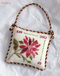 poinsettia ornament, crossstitch, cross stitch, knot