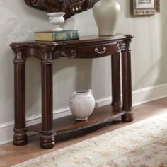 Aico Monte Carlo II Collection Console Table - Cafe Noir Color - Cafe Noir by Amini Innovation. $759.00. Deep carvings and intricate flourishes with mixed media accents and details. French and English dovetail construction on all drawers along with full velvet or cedar lining and metal ball-bearings with fully extendable suspensions. Birch solids and Cherry Veneers. Brand New from Authorized AICO Dealer. Cathedral Mahogany and Mapa Burl inlays throughout. If walls could take...