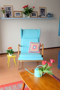 Crochet Pillow on turquoise chair! I adore this living room