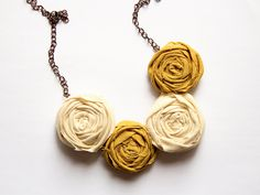 Autumn Fashion - Fabric Rosette Necklace - Fiber Necklace - Mustard Yellow and White Rolled Flowers, Statement Jewelry - Shabby Chic Chunky. $25.00, via Etsy.