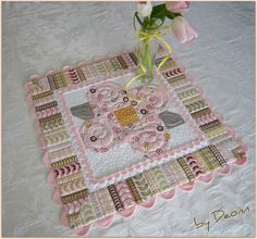 One of the best ways you can use your quilting is by making your very own home decor items like this quilted table topper. It's hard to find new spring quilt patterns this lovely, and you'll get to work with a lot of techniques while piecing it together.