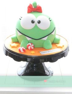 Elina from Bake-a-boo Cakes made this cute Cut The Rope Cake.  Her girl version of Om Nom is adorable.